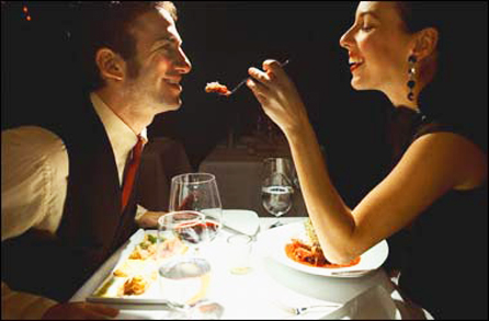 Couple having a meal in a restaurant --- Image by © Royalty-Free/Corbis